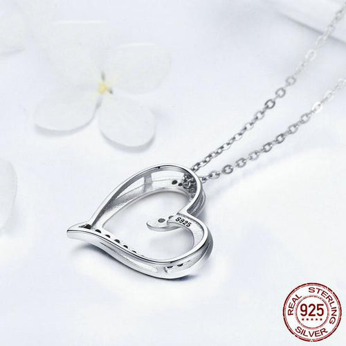 Women's Heart Shaped Pendant Necklace Crafted from Silver and Crystals