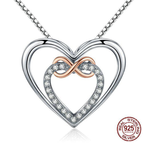 2 Hearts with Infinity Sign Pendant Necklace Crafted from Silver and Diamonds like Crystals