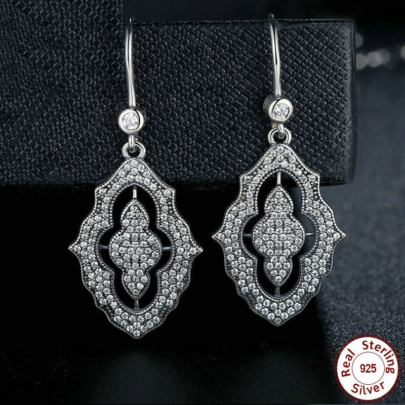 Vintage Style Drop Earrings Crafted from Silver and Diamonds like Crystals