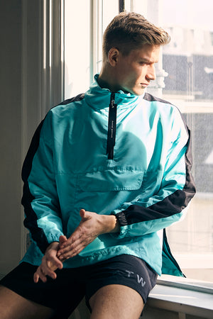 Anorak turquoise/black track pullover jacket