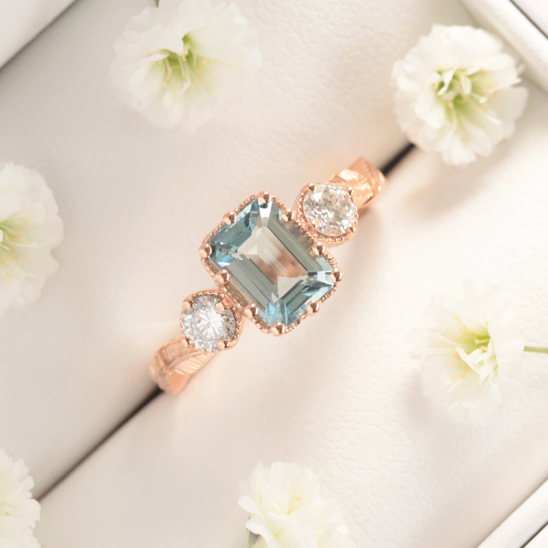 aquamarine and diamond nature engagement ring with leaves