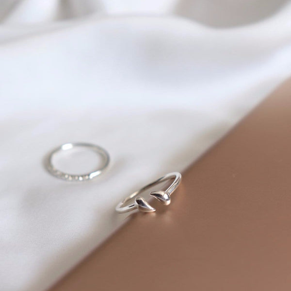 two white gold rings on silk
