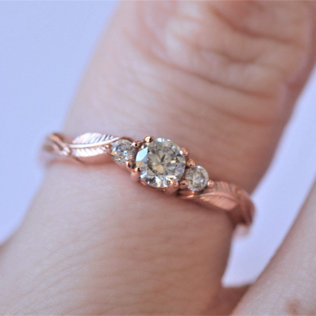 three diamond leaf engagement ring on hand