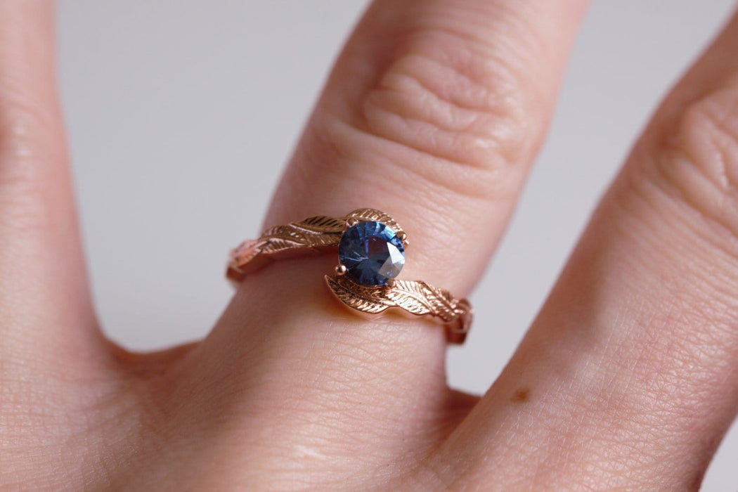 blue sapphire engagement ring on hand