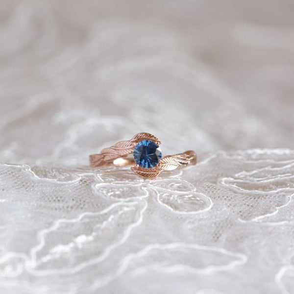 blue sapphire engagement ring on lace background