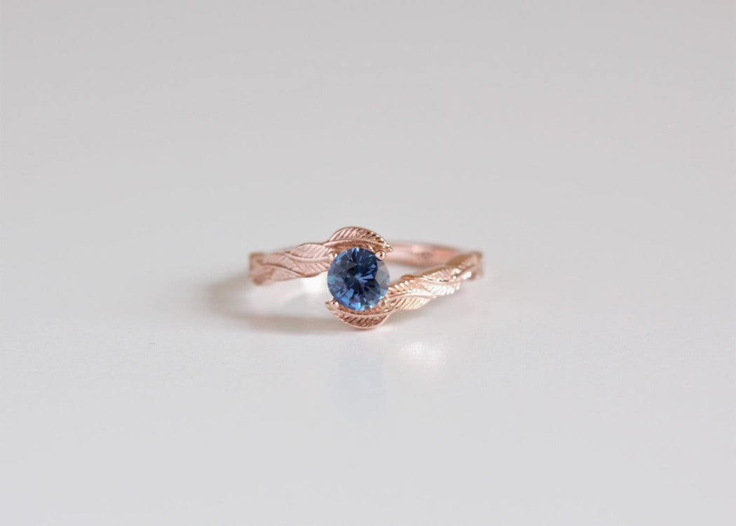 blue sapphire engagement ring on white background
