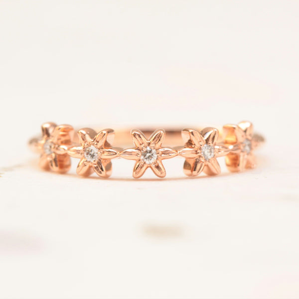 diamond flower wedding band in rose gold