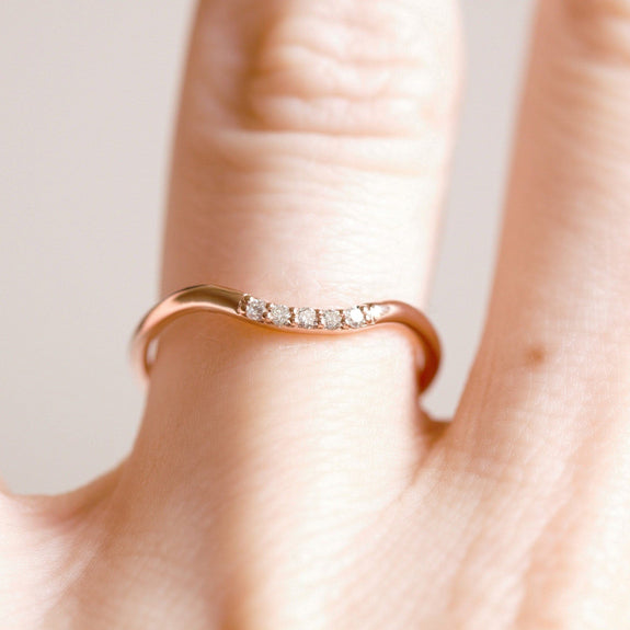 curved diamond wedding band in rose gold