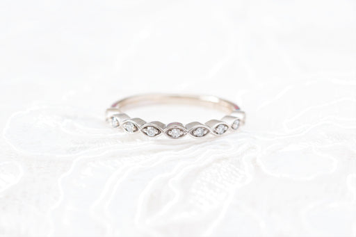 marquise shaped diamond wedding ring on white background