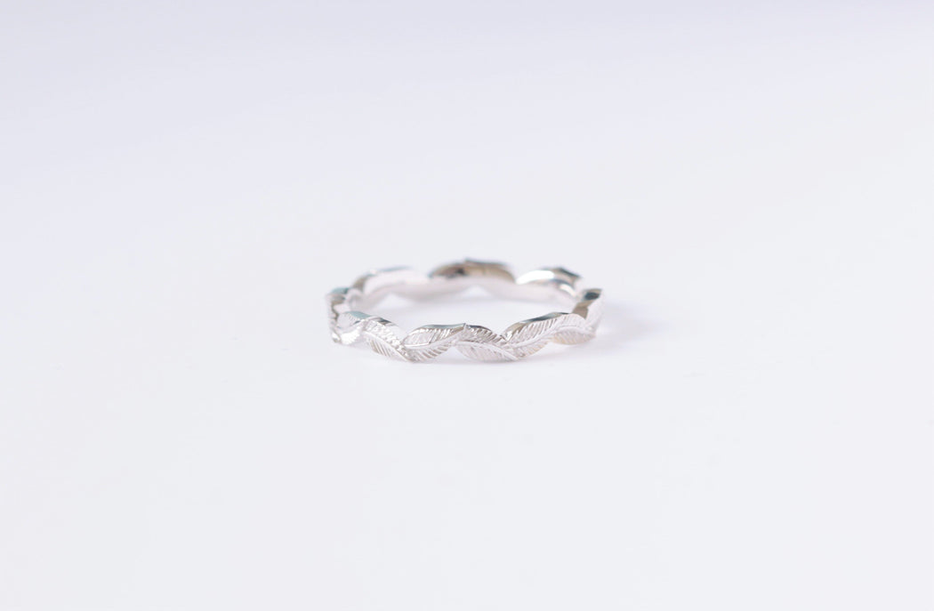 white gold eternity leaf ring on white background