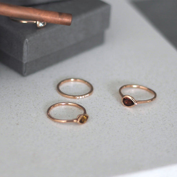 rose gold rings on granite