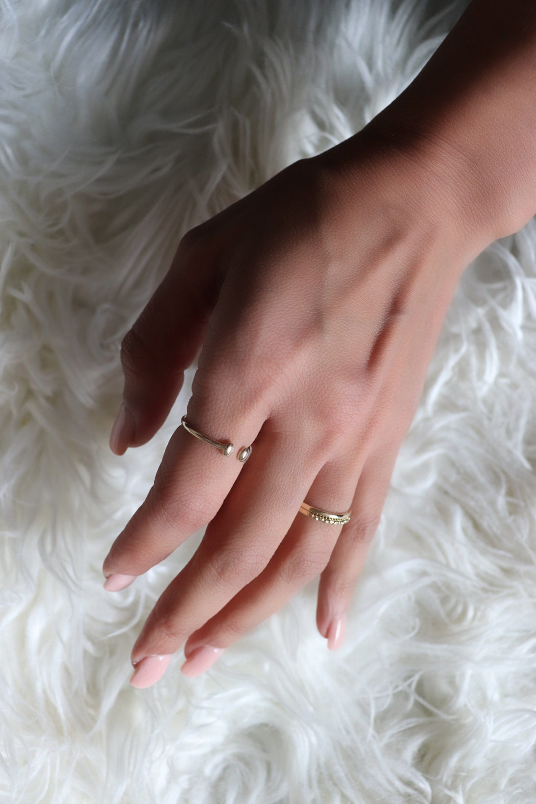 14k yellow gold rings on hand
