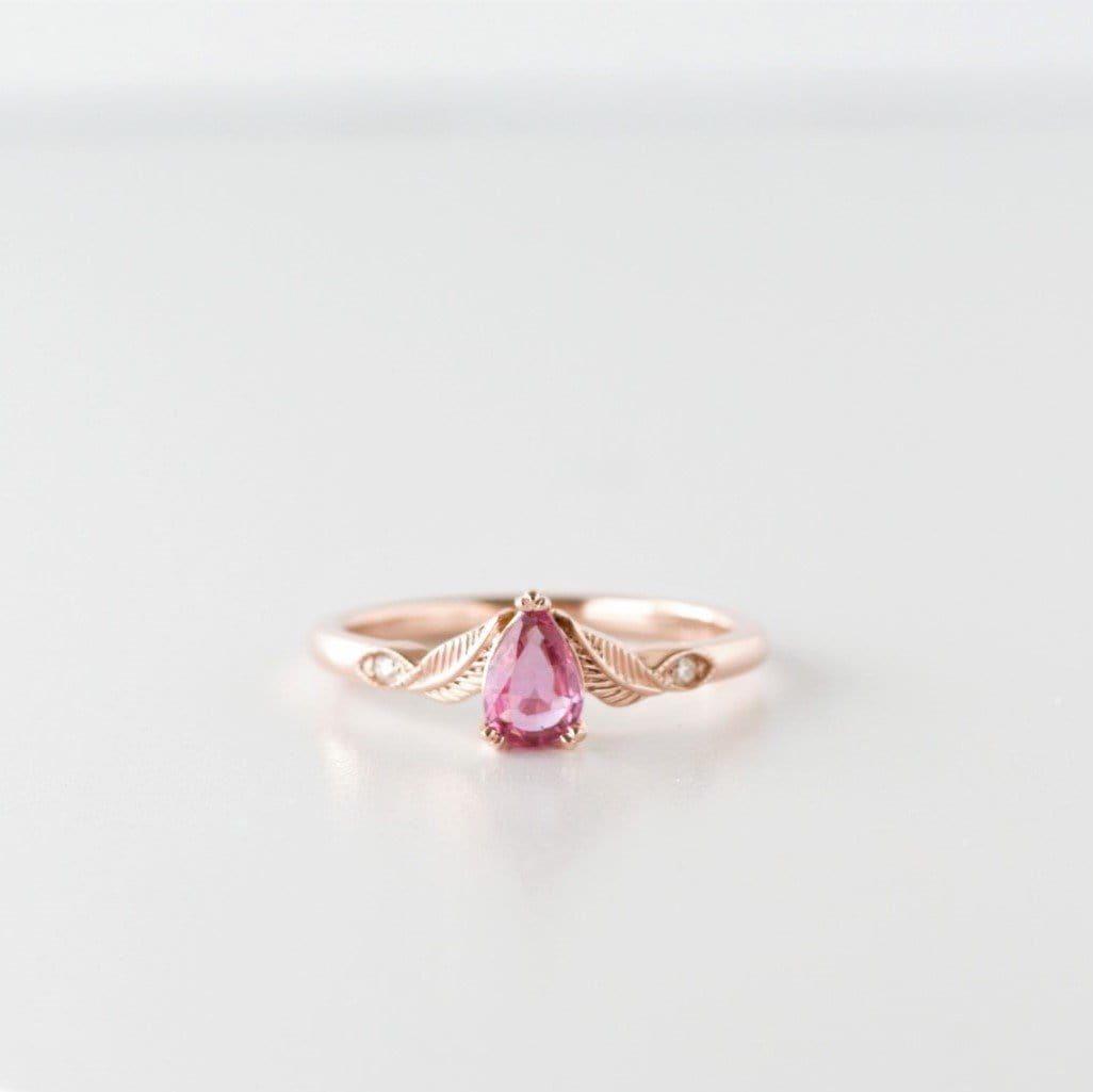 pink gemstone ring with leaf detail