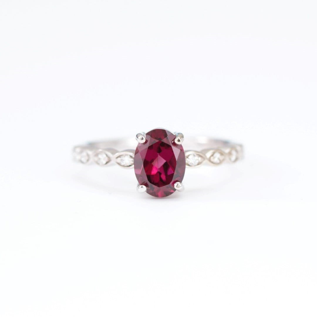 rhodolite garnet and diamond engagement ring on white background