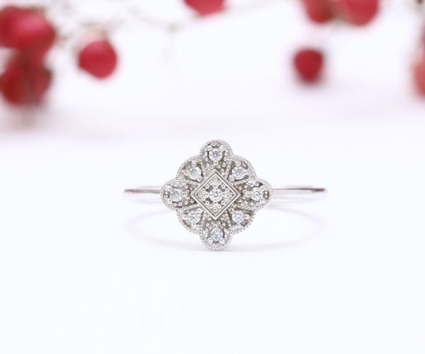 antique style engagement ring on white background