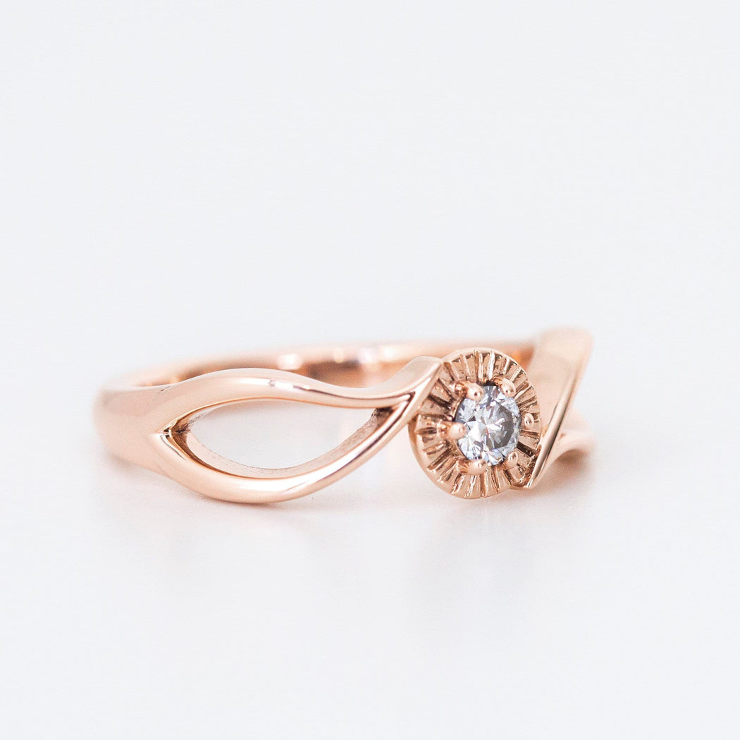 rose gold diamond leaf engagement ring on hand