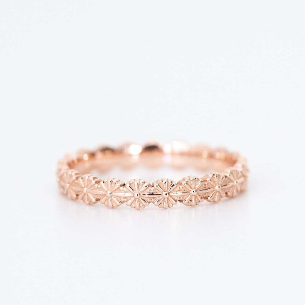 daisy full eternity ring in rose gold on white background