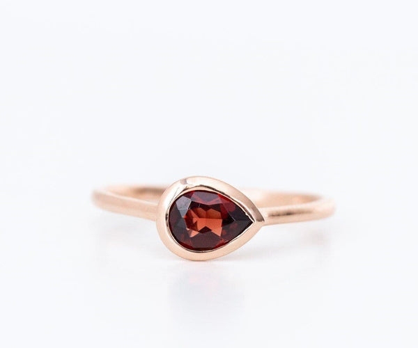 rose gold garnet engagement ring