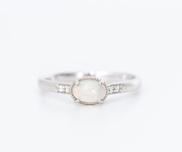 opal and diamond white gold engagement ring on white background