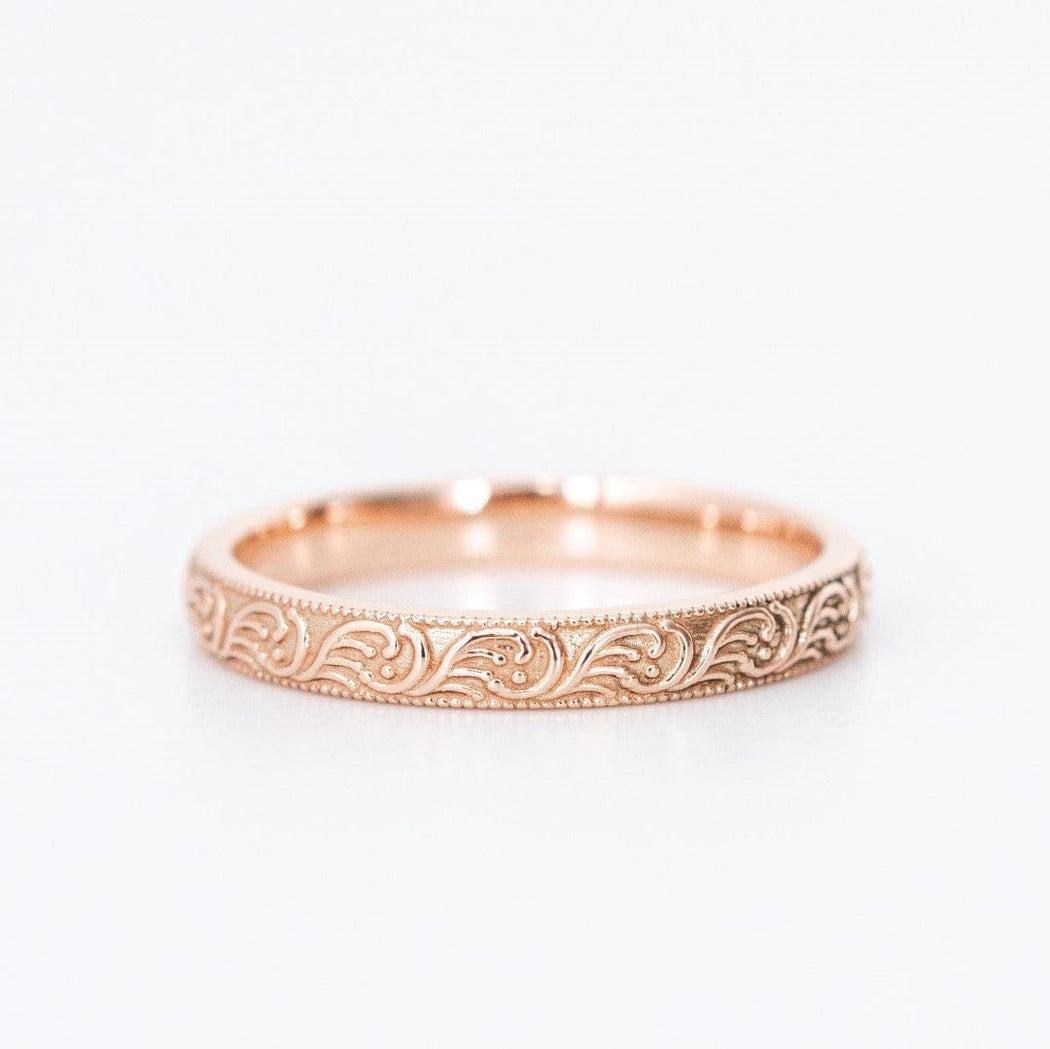 rose gold patterned ring on white background
