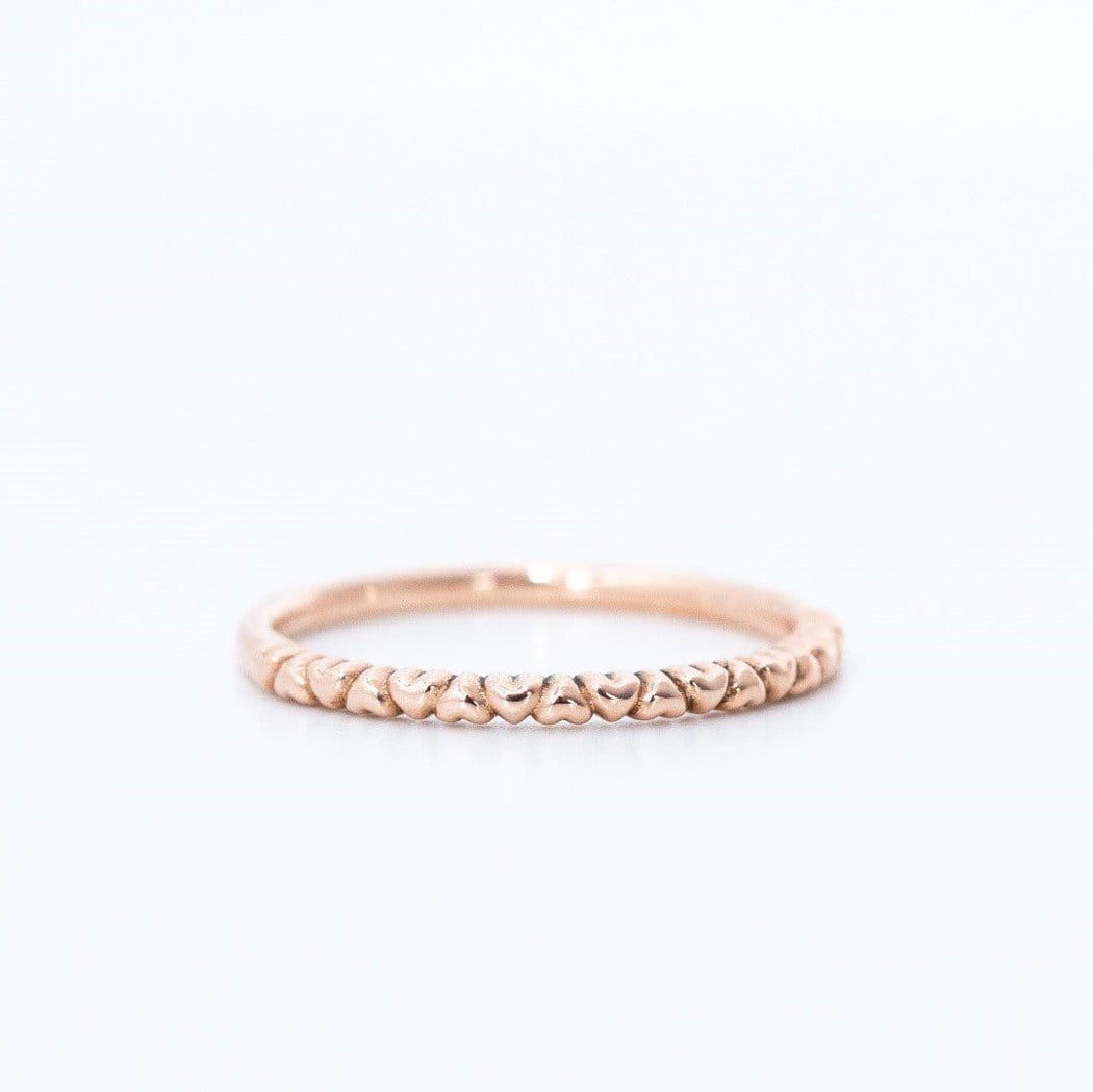 half heart eternity ring in rose gold