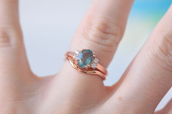 aquamarine and diamond ring on hand