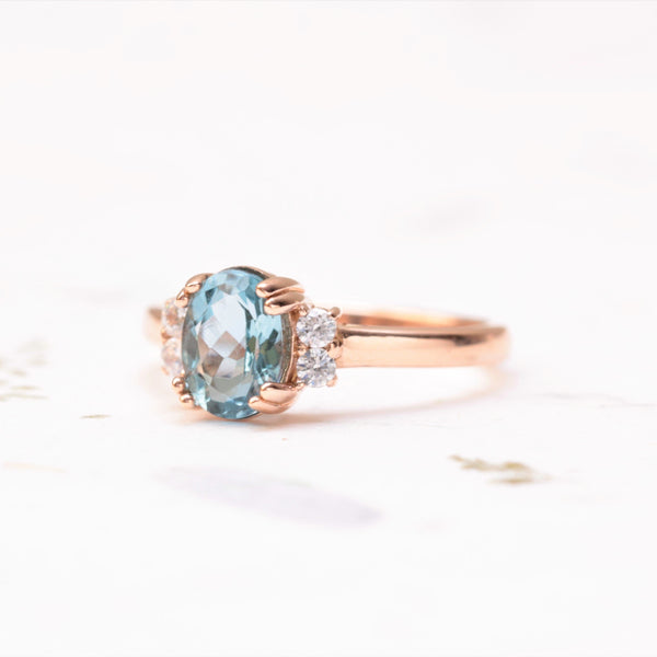 aquamarine and diamond ring on white background