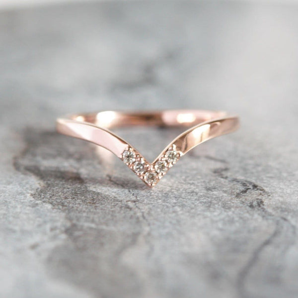 chevron diamond wedding ring on granite background