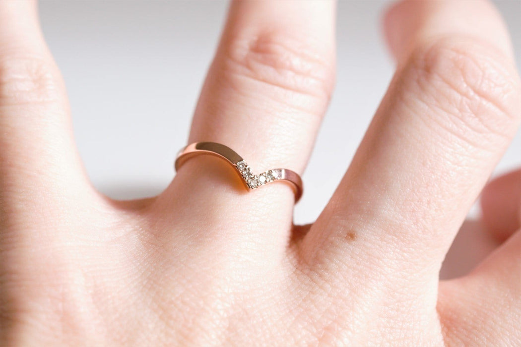 chevron diamond wedding ring on hand