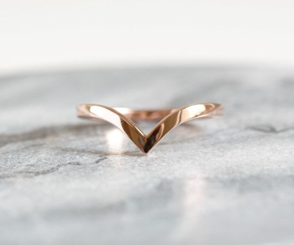 rose gold chevron wedding ring on granite background
