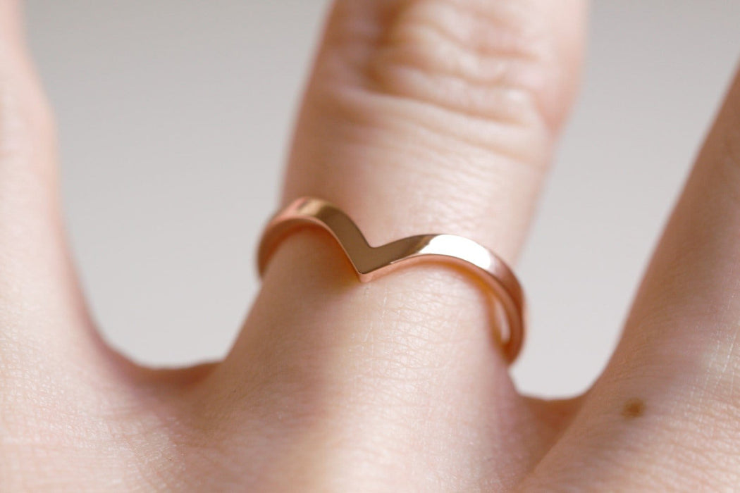 rose gold chevron wedding ring on hand