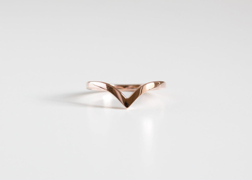 rose gold chevron wedding ring on white background