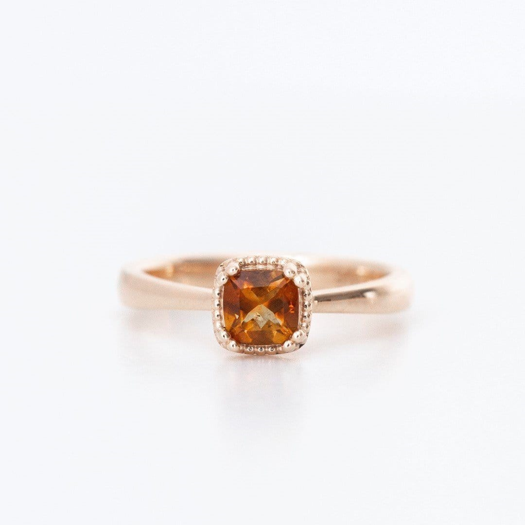 citrine and rose gold engagement ring on white background