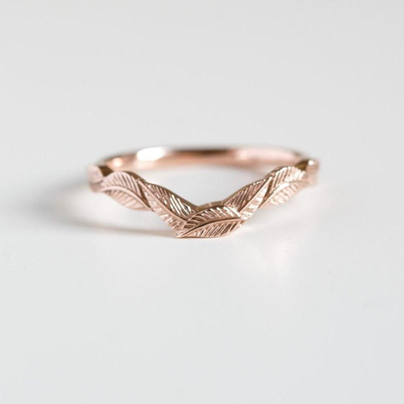 rose gold curved leaf ring on white background