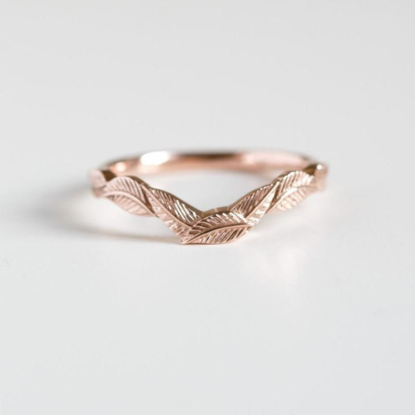 curved leaf rose gold ring on white background