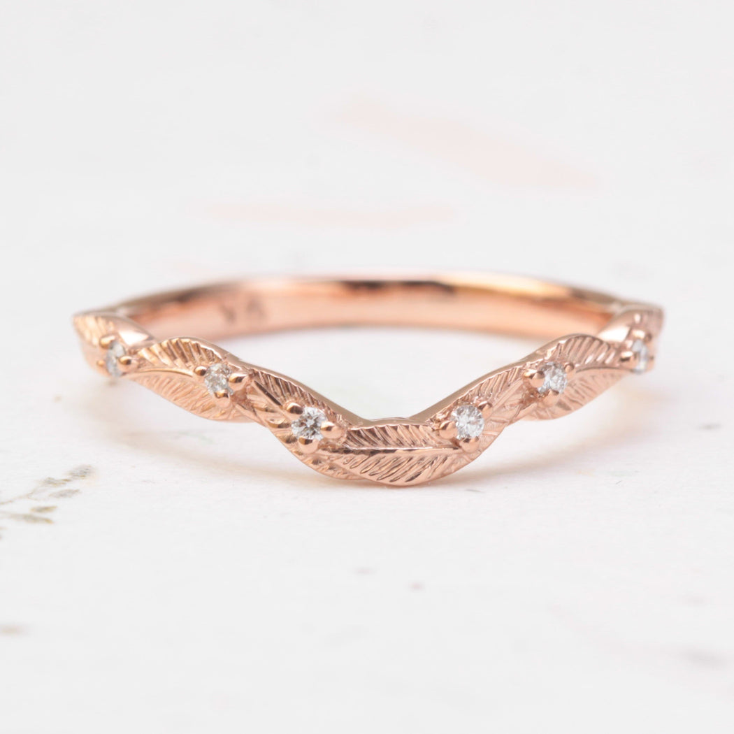 curved diamond leaf wedding ring in rose gold