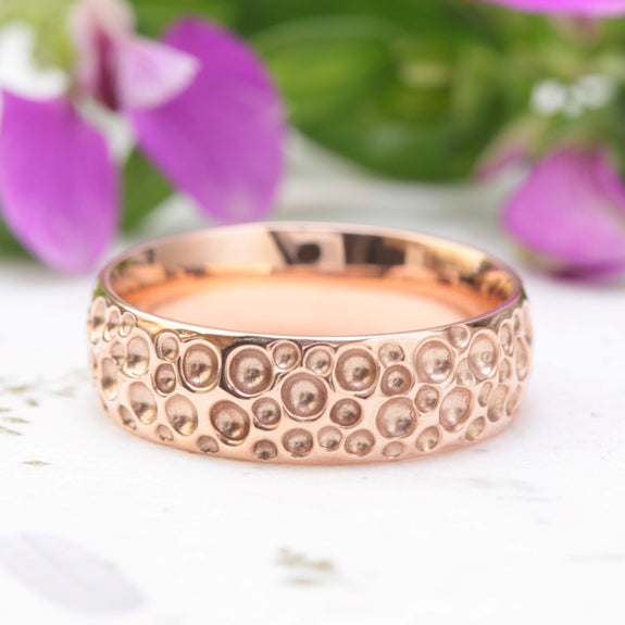 dimpled mens wedding ring rose gold