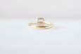 yellow gold engagement ring on white background