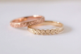 yellow gold daisy ring and rose gold ring on granite