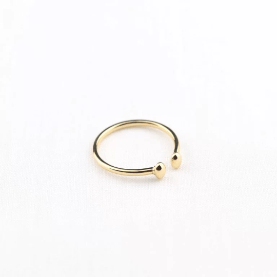 yellow gold stacking ring on white background