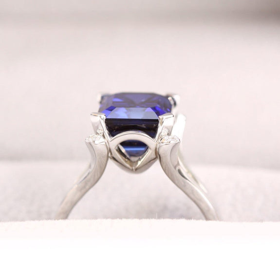 blue sapphire and diamond ring on white background