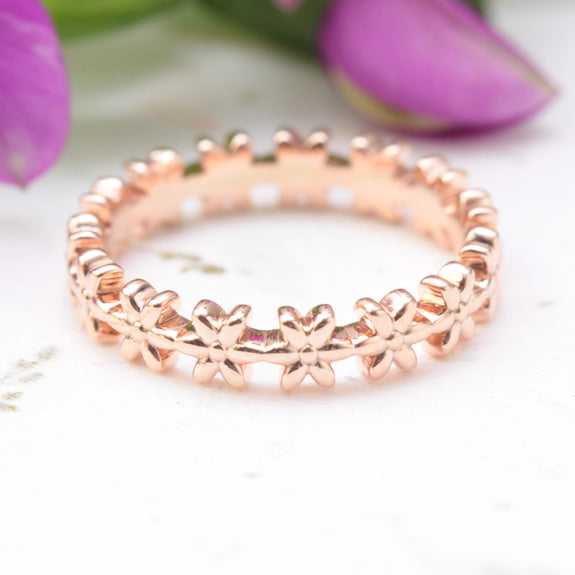 eternity flower wedding band in rose gold