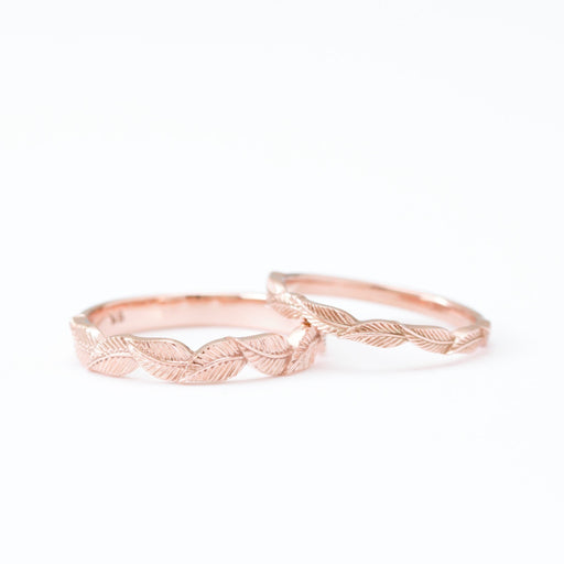 two rose gold leaf rings on white background