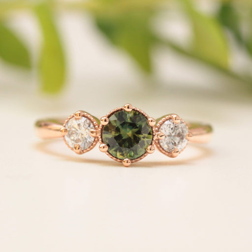 green sapphire and diamond engagement ring in rose gold