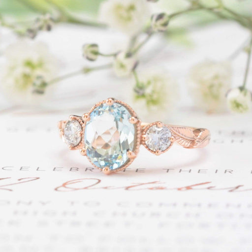 oval aquamarine and diamond nature engagement ring