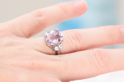 pink amethyst and diamond ring on hand