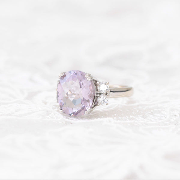 pink amethyst and diamond ring on lace background