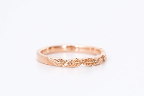 rose gold leaf wedding ring on white background