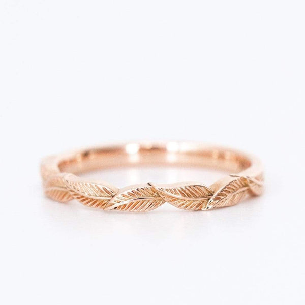 rose gold leaf ring on white background