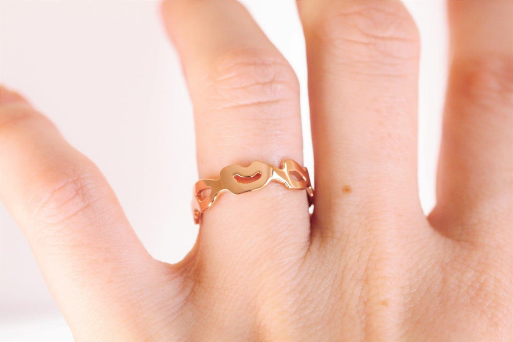 rose gold monstera ring on hand